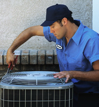 technician-servicing-ac-unit