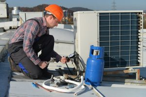 hvac-technician-recharging-refrigerant