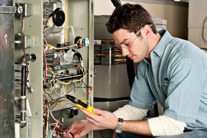 service-technician-tests-furnace-safely