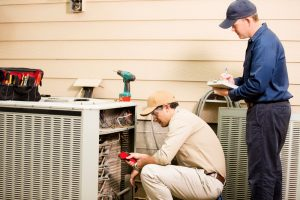 ac-technicians-working-on-ac-unit